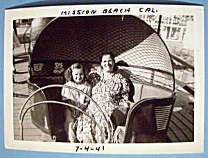 Photograph Of Woman & Girl On A Tilt A Whirl