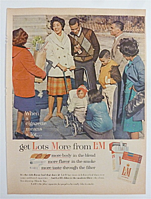 1963 L & M Cigarettes With Man & Woman Showing Off Baby