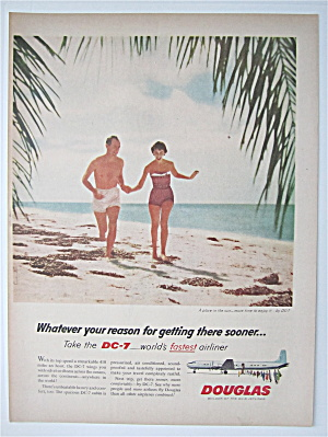 1957 Douglas Dc-7 Airliner With Couple Running On Beach