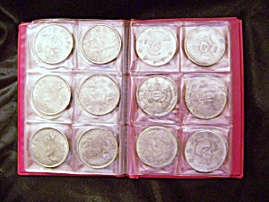 Lot Of 36 Chinese Medallions In World Coin Stock Book.