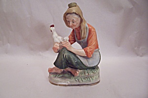 Farm Woman With Chicken