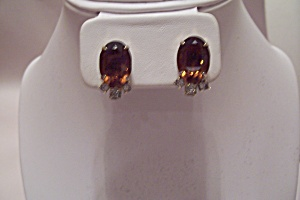Pair Of Goldtone Earrings With Emerald Cut Amber Stone