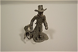 Cowboy With Saddle