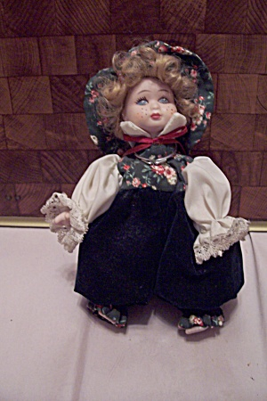 China Blonde Girl Doll In Floral Outfit