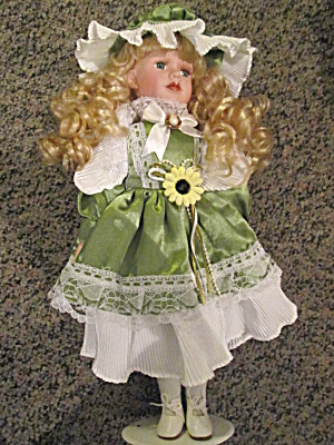 "Ashley Belle Porcelain 16"" Olive Green Doll"