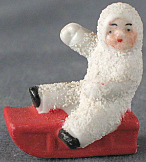 Antique Small Bisque Snowbaby On Sled