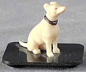Vintage Celluloid Puppy On A Black Base