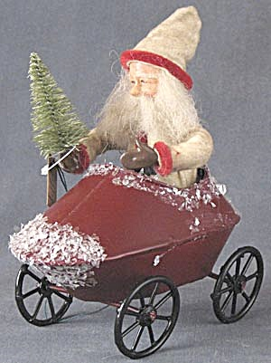 Santa In Metal Vehicle