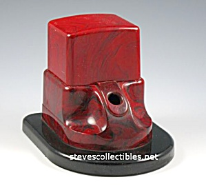 Early Streamlined Marbleized Red Plastic Inkwell