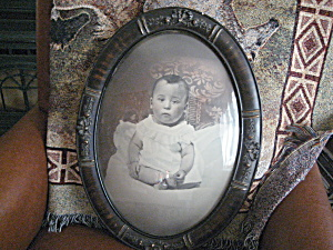 Curved Glass Frame Of A Little Boy