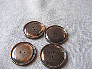 Four Plastic Brown Buttons